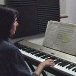 Anne Cabrera composing at her piano